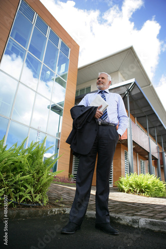 Director standing in front of his company