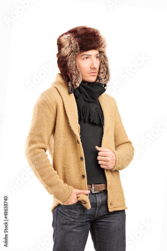 A smiling man with fur hat posing