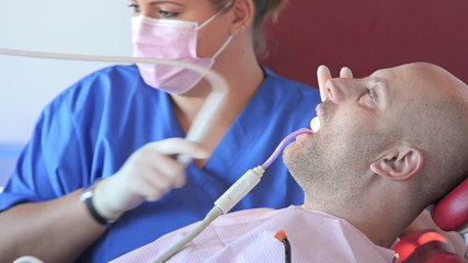 patient receiving details from his dentist about dental molds