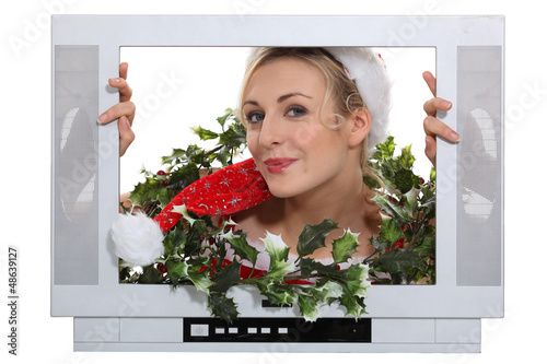 Woman in festive outfit escaping from television