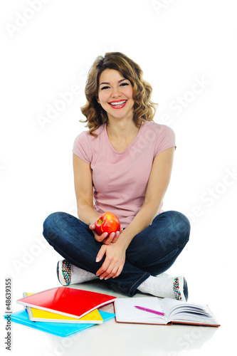 Young pretty female student with red apple isolated on white