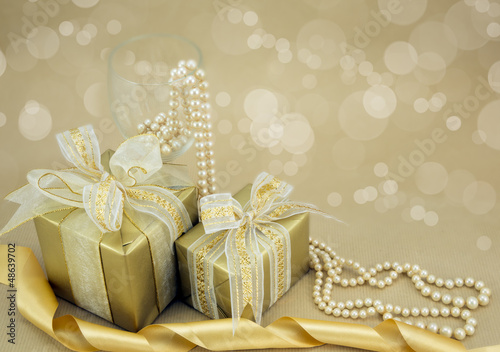 Gold presents with pearls and ribbon.