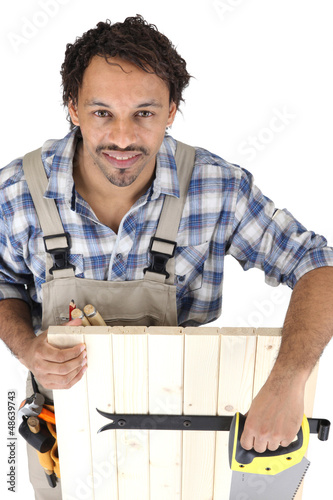 Carpenter with a saw
