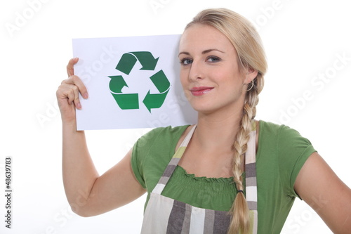 blonde woman showing the recycling symbol