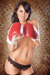 cute woman boxing topless wearing black panties