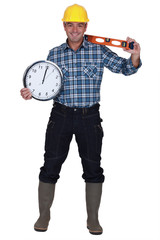 craftsman holding a clock and a level