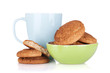 Cup of milk and bowl with cookies