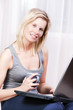 Beautiful blonde woman using a computer.