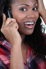 Woman receiving bad news over the phone