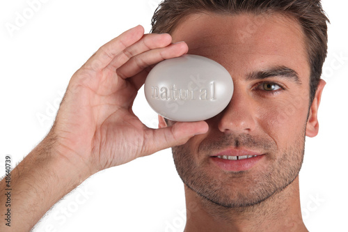 Man holding pebble