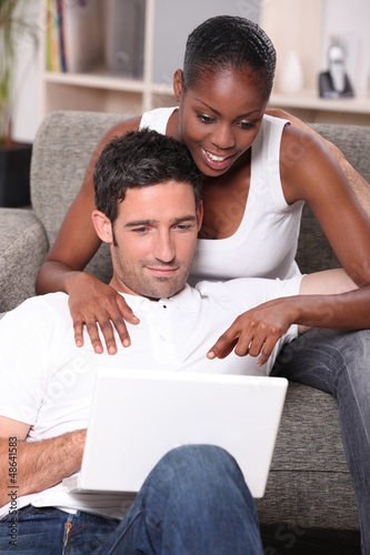 mixed couple surfing the net