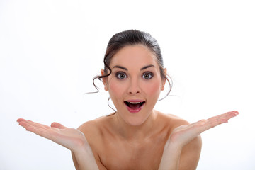 Amazed woman with bare shoulders
