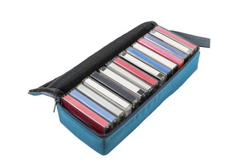Vintage audio cassette tape travel case isolated.