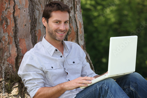 Man using laptop outside