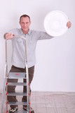 Man climbing step-ladder
