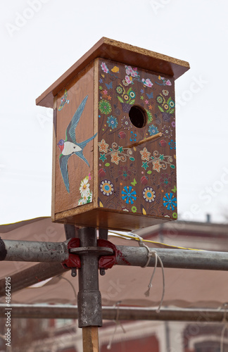 Nesting box against cloudy sky background