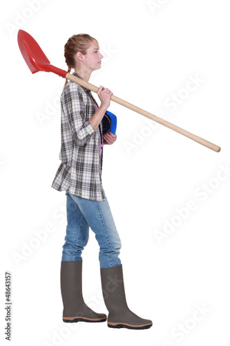 Woman with spade and hard hat