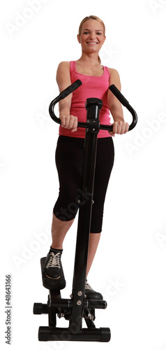 Blonde Woman Exercising on a Stepper