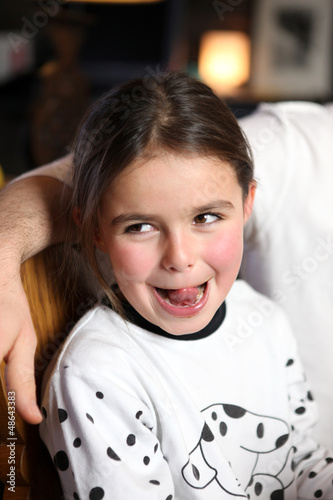 Young girl sticking out her tongue