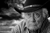 old cowboy against a stormy sky
