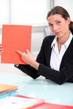 businesswoman pointing to a file left blank for your image
