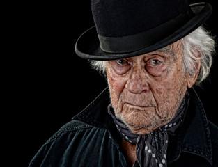 Old man wearing a bowler hat