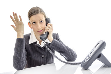 Frustrated woman making a phone call