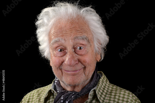Funny old man with white hair smiling
