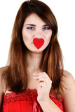 teen girl holding heart