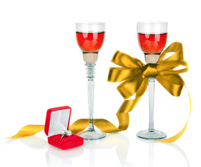 Wine in two wineglasses with golden satin  bow