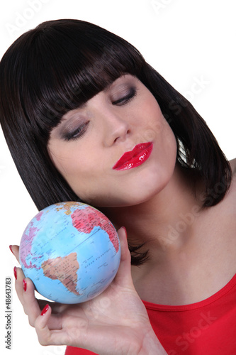 Woman holding a mini-globe