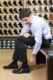 Young man trying on shoes