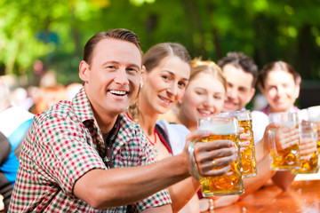 In Beer garden - friends drinking beer