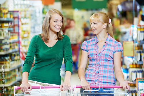 two women at supermarket shopping