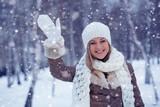 woman waving in winter park