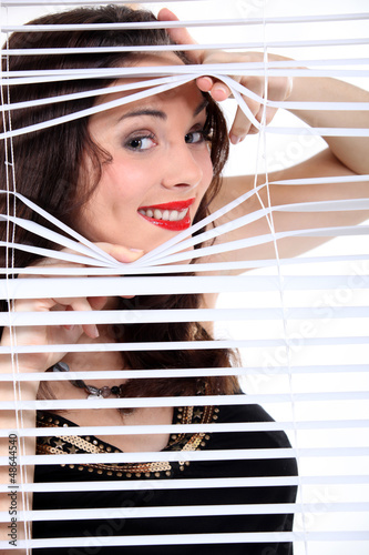 sexy woman looking through the blinds