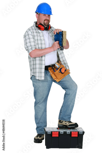 Man using power sander