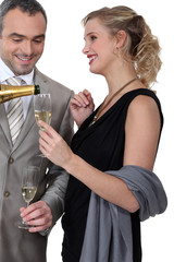 Glamourous couple drinking champagne