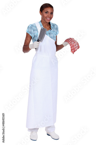 Woman butcher with ax and meat piece