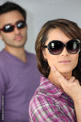 young woman and man wearing sunglasses