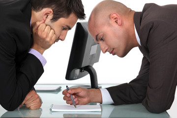 Businessmen looking through notes