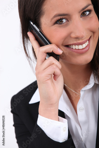 Young businesswoman holding mobile telephone