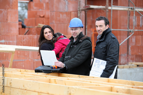 Architect and clients visiting site