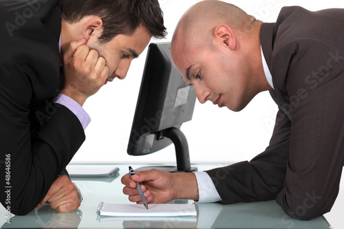 Businessmen looking through notes