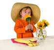 One little girl arranging flowers on the table