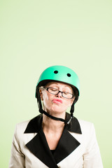 funny woman wearing cycling helmet portrait pink background real