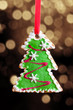 Gingerbread Christmas tree over soft glittery gold background