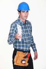 foreman holding blueprints