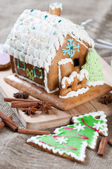 Gingerbread house and Christmas tree, vertical shot