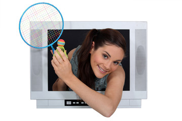 girl in TV screen with badminton racket
